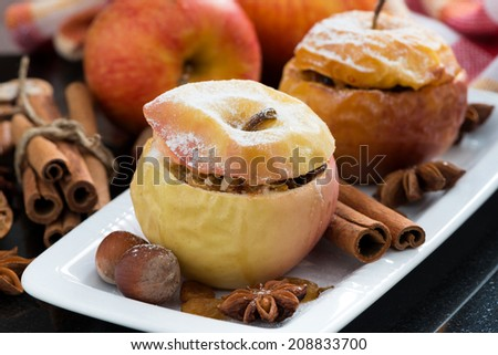 baked stuffed apples on a plate, close-up - stock photo