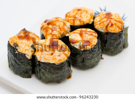 baked sushi rolls with cheese and soy sauce - stock photo