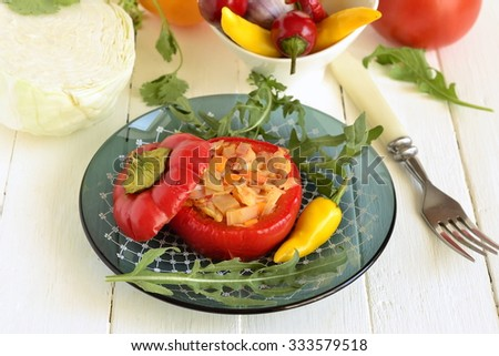 Baked sweet peppers stuffed with vegetables, vegetarian meal