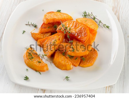 Baked sweet potato wedges with herbs. Selective focus - stock photo