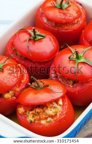 baked tomatoes filled with parsley, mushroom, tomato, bread crumbs and grated Parmesan cheese