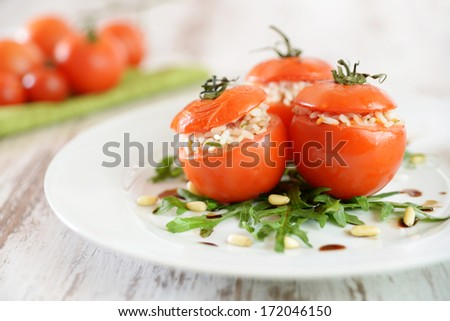 baked tomatoes filled with rice - stock photo