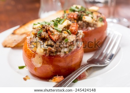 Baked Tomatoes Stuffed with Meat, Rice and Feta Cheese - stock photo