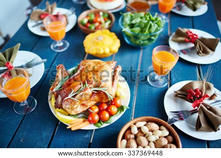 Baked turkey and other traditional Thanksgiving food on served table