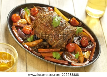 Baked veal with vegetables - stock photo