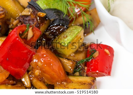 Baked vegetables as a garnish for grilled pork fillet. Macro. Photo can be used as a whole background.