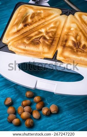baked walnut bread on the open toaster.Selective focus - stock photo