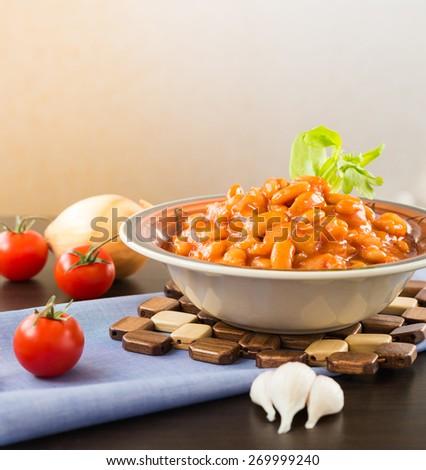 Baked white beans in tomato sauce - stock photo