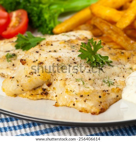 Baked white fish fillet. Selective focus.