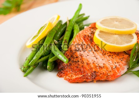 Baked Wild Alaskan Salmon Served with Green Beans - stock photo