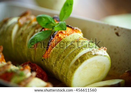 Baked zucchini stuffed with vegetables - stock photo