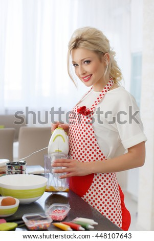 Woman Decorating Cupcakes cupcake stand stock photos - people images - shutterstock