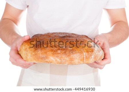 Baker holding fresh made bread isolated on white background. Baker and bakery. - stock photo