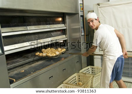 Baker preparing bread