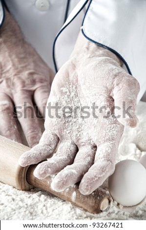 Baker's palm covered with flour, close-up - stock photo