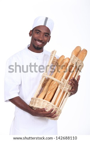Baker with a basket of baguettes