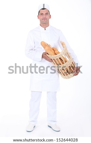 Baker with bread basket - stock photo