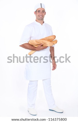 Baker with loaves of bread - stock photo