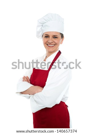 Baker woman posing with confidence, arms crossed - stock photo