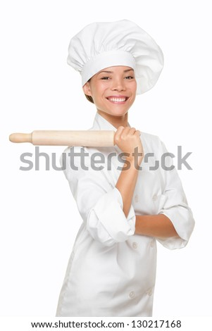 Baker woman smiling proud with baking rolling pin. Chef or baker in uniform hat hat smiling happy portrait isolated on white background. Multiracial Caucasian Asian woman baker. - stock photo