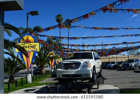 BAKERSFIELD, CA - APRIL 4, 2017: This well-maintained used car lot is quiet on a sunny weekday morning. Business has been slow lately.