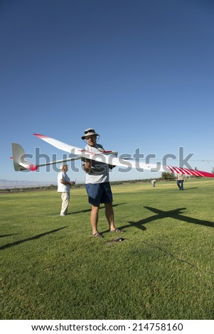BAKERSFIELD, CA-AUGUST 24, 2014: An unidentified contestant powers the electric winch with his foot as he launches his glider in the monthly contest hosted by the Southern San Joaquin Soaring Society. - stock photo