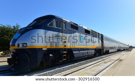 BAKERSFIELD, CA - AUGUST 2, 2015: The Caltrans and Amtrak California logos are prominently displayed on this diesel-electric passenger locomotive. - stock photo