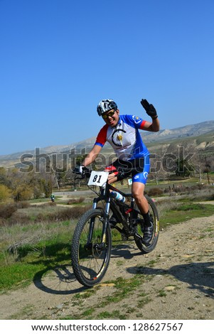BAKERSFIELD, CA-FEB 17: An unidentified male rider powers up a steep hill during the Foothill Classic Mountain Bike Race on February 17, 2013, in Bakersfield, California.