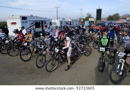 BAKERSFIELD, CA - JAN 14: Cyclists line up for the start of the Rio Bravo Rumble biathlon (running and mountain biking) on January 14, 2012, in Bakersfield, California. - stock photo