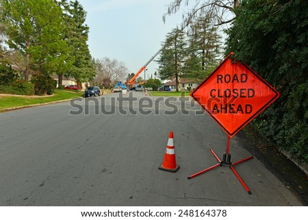 BAKERSFIELD, CA - JANUARY 29, 2015: Pacific Gas and Electric Company moves into a residential neighborhood with heavy equipment to replace an electrical pole. - stock photo