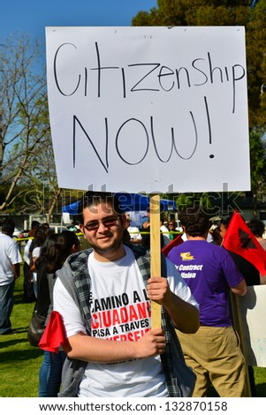 BAKERSFIELD, CA - MAR 24: An unidentified participant proudly proudly displays his sign at a rally for a new immigration law on Cesar Chavez Day on March 24, 2013,  in Bakersfield, California.
