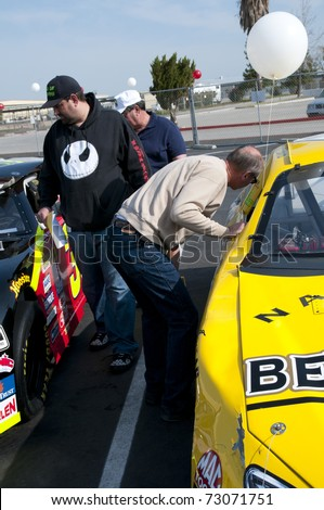 BAKERSFIELD, CA - MAR 12: NASCAR sponsor holds public auction for all their cars and parts on March 12, 2011 in Bakersfield, California. Buyers inspect racing cars prior to bid.