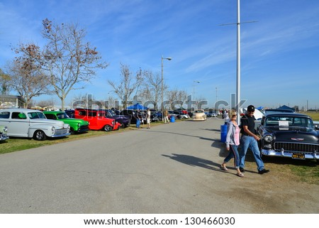 BAKERSFIELD, CA-MAR 2: Old friends meet and car fanciers are treated to exotic car displays at the Cruisin' For A Wish Car & Motorcycle Show on March 2, 2013, in Bakersfield, California.