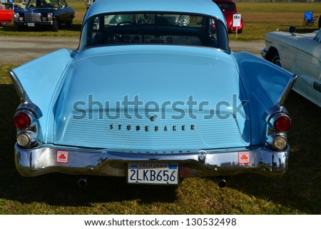 BAKERSFIELD, CA-MAR 2: This unique Studebaker Hawk is bringing back memories for the visitors to the Cruisin' For A Wish Car & Motorcycle Show on March 2, 2013, in Bakersfield, California. - stock photo