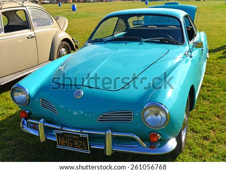 """BAKERSFIELD, CA - MARCH 14, 2015: A rear engined 1965 Karmann Ghia, based on the Volkswagon chassis,  in bright turquoise paint, is exhibited at the """"Cruisin' for a Wish"""" classic car show - stock photo"""