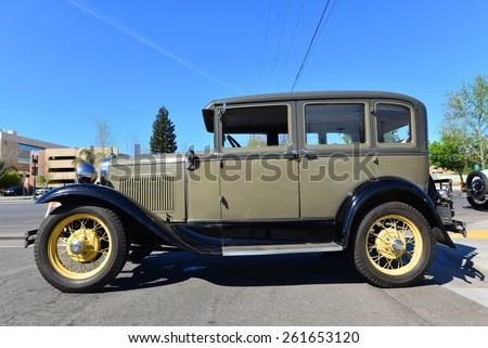 BAKERSFIELD, CA - MARCH 14, 2015: Members of the local Ford Model A club get together today to discuss their cars and socialize. This pristine 1930 four door sedan is present. - stock photo
