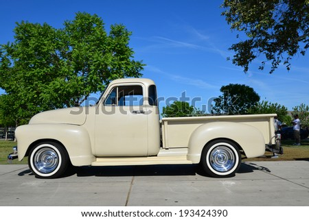BAKERSFIELD, CA-MAY 17, 2014: A 1953 Chevrolet five window pickup truck has been given new life and is on display at the South High School Car Show. - stock photo