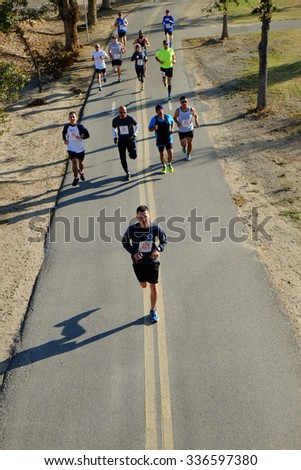 BAKERSFIELD, CA - NOVEMBER 7, 2015: All ages and abilities start together for the 33rd Annual Bakersfield Police Department Memorial Run. Faster runners move quickly to the front. - stock photo