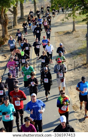 BAKERSFIELD, CA - NOVEMBER 7, 2015: All ages and abilities start together for the 33rd Annual Bakersfield Police Department Memorial Run. Faster runners move quickly to the front.