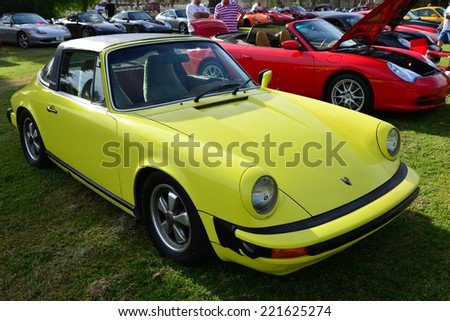 BAKERSFIELD, CA - OCTOBER 4, 2014: A Porsche 911S Targa, circa 1970s, is looking pretty for the local Porsche club's  Concours D'Elegance.  - stock photo