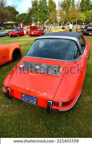 BAKERSFIELD, CA - OCTOBER 4, 2014: Mike Thomas is displaying his red Porsche 911T with Targa body  at the local Porsche club's Concours D'Elegance. The 911 is the quintessential sports car for many. - stock photo