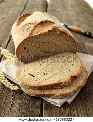 Bakery bread on old wooden boards
