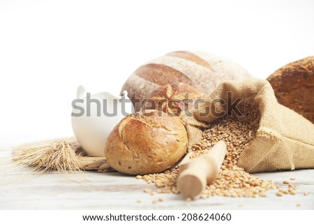 Bakery Bread.Various Bread and Sheaf of Wheat Ears Still-life.  - stock photo