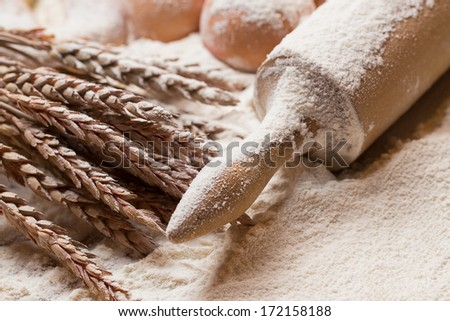 Bakery. Eggs and rolling pin in the flour