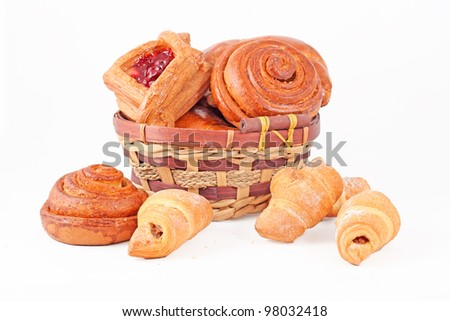 Bakery foodstuffs assortment in the basket - stock photo