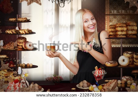 Bakery. Happy Saleswoman with Cup of Coffee in Bakeshop - stock photo