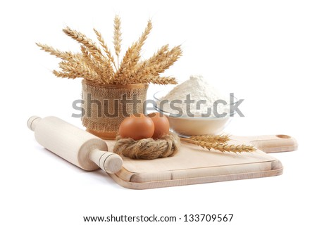Bakery ingredient. Flour with raw eggs for making dough isolated on a white background.