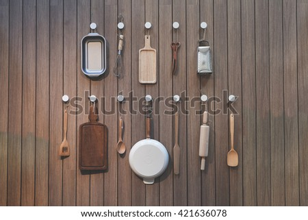 Bakery making equipment hanging on the wall, image applied with filter color - stock photo