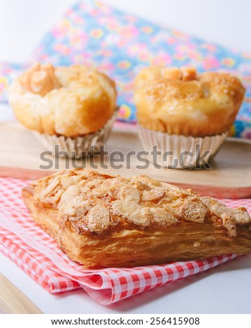 Bakery product assortment with chicken sausage cup bread, Butter Croissant and Glassa Danish - stock photo