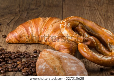 bakery products and coffee beans on a wooden table